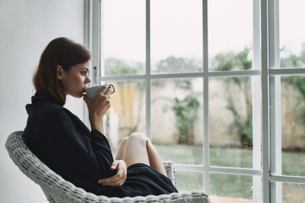 woman drinking coffee thinking about anxiety during a pandemic
